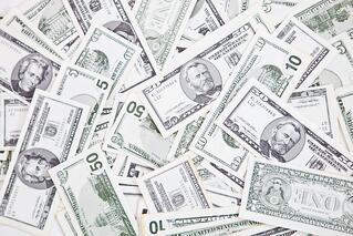 Closeup to a bunch of dollar bills - money concepts.jpeg
