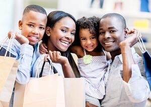 Happy family shopping on tax-free weekend