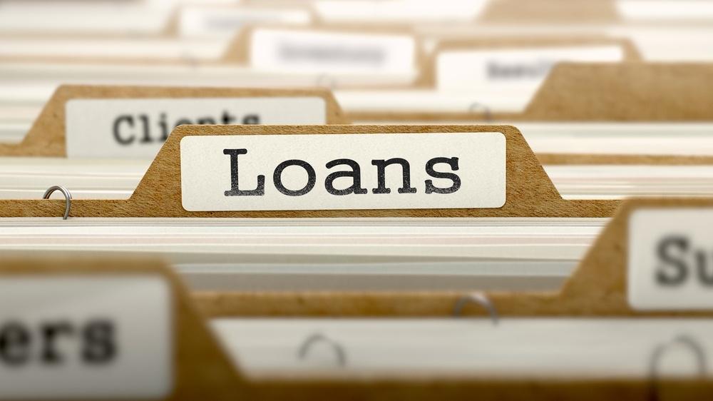 Loans Concept. Word on Folder Register of Card Index. Selective Focus..jpeg