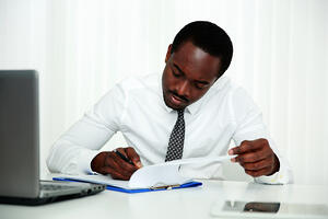 Man reading personal finance tips