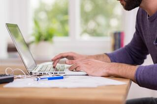 Man working on taxes.jpeg