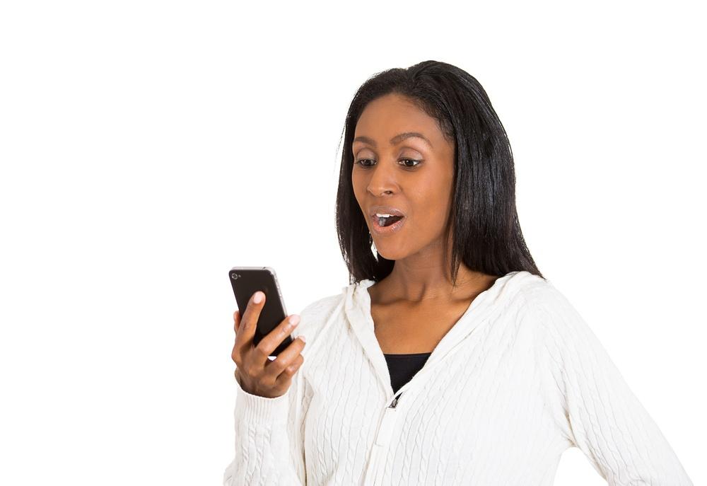 Woman using savings apps.jpeg