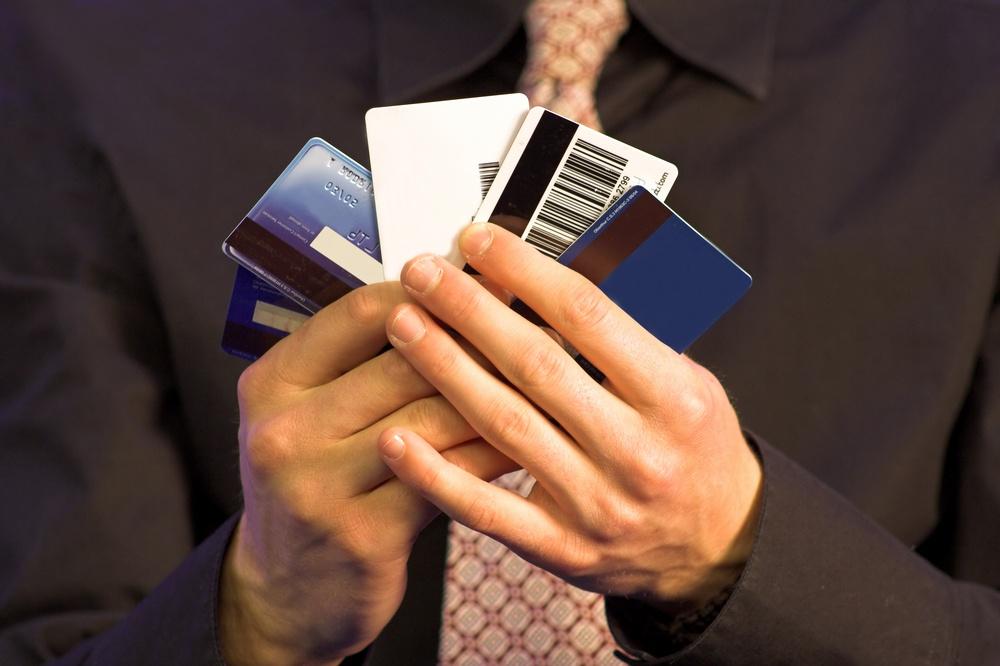 business man holding credit cards.jpeg