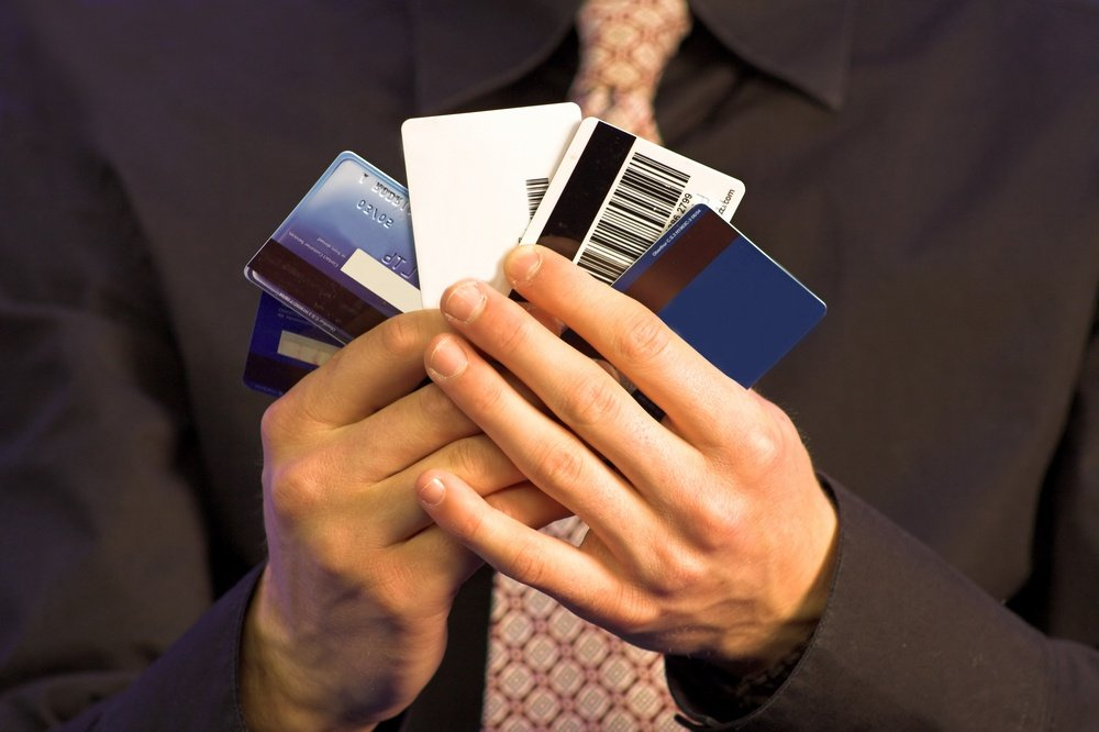 business man holding credit cards.jpeg