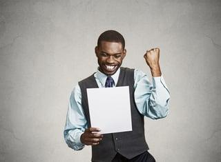 excited man looking at tax return.jpeg