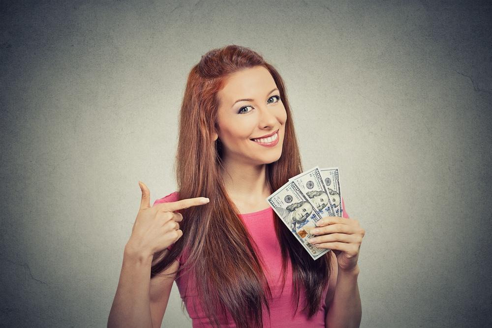 happy woman with tax advance loan.jpeg